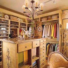 This once rarely-used spare room was transformed into a swanky closet that's used every day. Hanging rods and open shelves line the walls while a new island provides a convenient drawer-filled surface for folding and packing clothes. The wall opposite the island stores shoes, all neatly stacked in clear acrylic shoeboxes. High storage is reserved for less frequently used items.