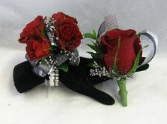 Beautiful red spray roses stand out against the beautiful shear white and black ribbon.  The silver gyp just sparkles in between the red of the roses.  This corsage is designed on one of our crystal and pearl bracelets.  Makes for a great lasting keepsake.