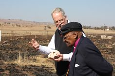 Archbishop Emeritus Desmond Tutu gets a lesson in evolution from Wits professor Frances Thackeray at the Sterkfontein Caves in the Cradle of Humankind on July 31