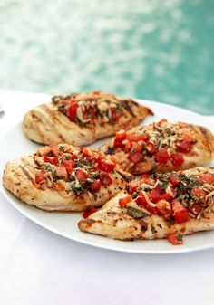 Bruschetta Chicken — Fresh basil and tomato combine for a chicken dish that rivals the bruschetta at your favorite Italian restaurant.