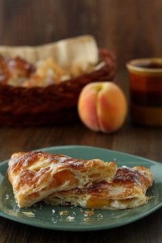 Peach Pie Cheesecake Turnovers are easy to bake up quickly thanks to puff pastry dough. Perfect for when you want cheesecake now but don't want have to bake one. Get the recipe at www.chocolatemoosey.com