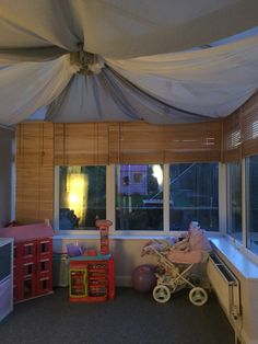Close up of playroom I have created for my daughter in my conservatory! Ceiling drapes/fabric swag have helped me make it pretty and cosy!!