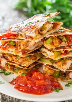 Take BBQ chicken and pair it with bell peppers and Tex-Mex cheese for a deliciously simple fajita quesadilla.