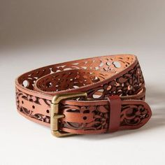 MILADY BELT - A rustic and romantic floral pattern gives vintage appeal to this intricate, leather belt.