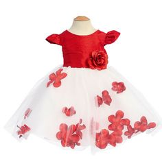 Silk Baby Dress with Flower Petal Skirt in Red:  This dress features a 100% silk red bodice and a matching waistband with a detachable floral accent. The white tulle skirt boasts beautiful faux flower petals inside the skirt which can be removed. You can even place your own fresh petals inside the skirt for a touch of fragrance that will add to the wedding ceremony or to match the bridal bouquet.