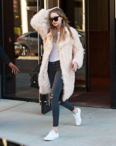 Spring may be just around the corner, but the frigid temps are holding tight in New York City. Normally we'd be all fussy and impatient about it, but the pink faux fur coat Gigi Hadid wore has us rethinking our stance on the lingering chill. Maybe a little wintry weather isn't so bad—if it means you get to cozy up in a fuzzy beauty like this.