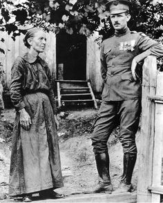Medal of Honor and Croix de Guerre recipient Alvin York photographed with his mother back home in Tennessee, 1919.  York received both awards during the 1918 Meuse-Argonne Offensive (or the Battle of Argonne Forest) when he charged a German machine-gun nest own his own, killing 25 Germans and capturing 132 others in two separate forays. A biographical film was produced in 1941, Sergeant York, starring Gary Cooper as York.