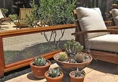 The outdoor wire mesh decorative fence divides the space and compliments the overall landscape design.