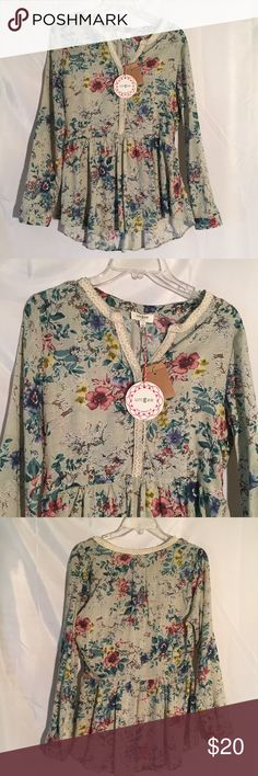 NEW Umgee long sleeve floral top shirt S NEW Umgee long sleeve floral top shirt Size S. 65% Cotton 35% polyester umgee Tops Blouses