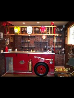 The hubby's man cave? A unique bar in a family room remodel. Any firefighter would love to have this bar a mockup of an antique fire engine. Complete with lots of brass diamond plate red lights a brass bell even a hose bed. Firefighter Bar, Firefighter Tattoos, American Firefighter, Firefighter Wedding, Man Cave Home Bar, Man Cave Garage, Garage Bar, Fire Engine, Bars For Home