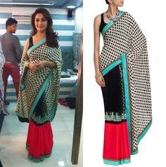 GET THIS LOOK: Madhuri Dixit Nene looks stunning in the ivory polka dot sari from Sabyasachi Mukherjee on the sets of her ongoing TV show.  Shop the sari at http://www.perniaspopupshop.com/designers-1/sabyasachi/sabyasachi-20 — with Nazneen Chowdhury.