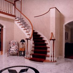 Two-toned curved staircase. For more information visit www.carstensenhomes.com