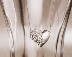 Garosu Girls Of Two Hearts necklace. Contemporary styling makes this heart very special. Matte silver.  From www.moxyst.com