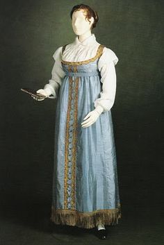 'Blue Jane Austen Dress, Experiments in Elegance: How to Fake Regency - A Guide to the Silhouette'. I have been told by a curator that this version of the gown is altered from the original. No pleat in centre of skirt and hem fringe an added decoration at later date.