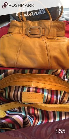 Clarks Shoulder bag Beautiful, mustard-colored, leather Clarks shoulder bag. Leather is super-soft! Measures 16 inches wide and 12 1/2 inches tall. Lining is a pretty stripe and shown in photo. Multiple pockets and zippered mid-section inside. Clarks Bags Shoulder Bags