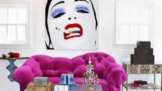 From the pop art to the hot pink tufted couch, this sitting area is EVERYTHING.