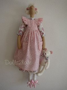 Tilda doll Bambi wearing a dress with a print of by Dolls2love