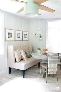 settee for kitchen table black curtains and valances how to create a stylish dining nook with modern decor contemporary cottage makeover