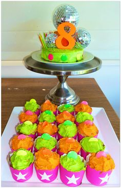 Disco Ball cake with neon iced cupcakes
