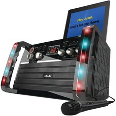 Akai KS-213 CD+G Karaoke Player with iPad Cradle.  Really like the karaoke machine for what it is. It's loud, has multiple functions that you can use (auxiliary, CD, etc.) and also a spot for 2 mics. The strobe lights are really cool, too.Compare price and buy online with in low price.