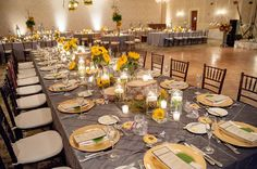 Captains table with silver linen accented with sunflower centerpieces by Emerald City Designs