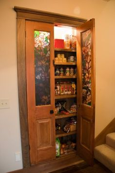 built in pantry with antique doors (that is not stained glass it is just textured imitation stain glass contact paper