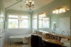 Really like the color scheme... Sea Grean walls, whites and creams and dark vanity... Only change, I would chose lighter top