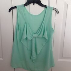 Sheer Bow-Back Blouse Worn about 4 times, but it looks brand new!! The pink spot is just the tag on the back peeking through the sheer fabric. Purchased from a boutique last summer. Comment below to bundle or if you have any questions. Feel free to use the offer button on  all of my listings prices are always flexible! Tops Blouses