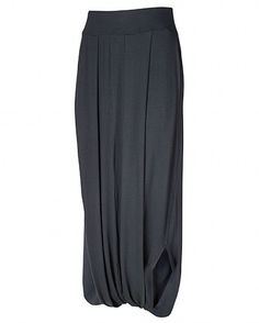 """The harem skirt has the same concept as the harem pants. The skirt is full length and has a band at the bottom letting it be tight at the ankles and loose in between the two bands.""""Bliss Harem Skirt."""" Sweaty Betty. N.p., n.d. Web. 24 Apr. 2013."""