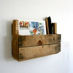 wall mount recycled wood pallet shelf for vinyl record or curio storage designed by Elsa Henderson. $25.00, via Etsy.