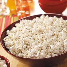 Pizza Popcorn. 2-1/2 quarts popped popcorn, 1/3 cup butter, cubed, 1/4 cup grated Parmesan cheese, 1/2 tsp garlic salt, 1/2 tsp dried oregano, 1/2 tsp dried basil, 1/4 tsp salt, 1/4 tsp onion powder. Place popcorn in an ungreased 13-in. x 9-in. baking pan. Melt butter in a small saucepan; add the remaining ingredients. Pour over popcorn and mix well. Bake, uncovered, at 350° for 15 minutes.