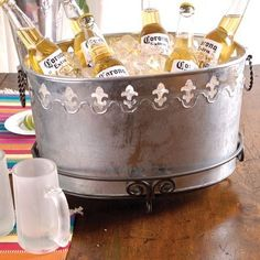 "Galvanized Tin Fleur De Lis Ice Beverage Tub,Stand Not Included by First Alliance Marketing Group, LLC. $29.95. Perfect Gift. Stand Not Included. Size: 16""W x 9""H. Galvanized Tin Fleur de Lis Ice Tub. Very Cool Galvanize Tin Fleur De Lis Ice Tub with convenient handles. This 16"" Beverage Ice Bucket is the perfect gift with fun style sure to be a party hit. Bottom stand not included."