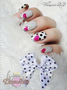 White Nails with big & small black polka dots & a single fuschia heart nail art