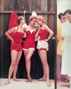 Women at the beach in the 50s. I adore the classic red