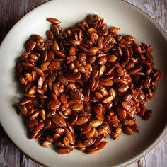Roasted Pumpkin Seeds. Karen's honey-sriracha recipe bakes these pumpkin seeds with spices (smoked paprika, ginger, cumin), apple cider vinegar, EVOO, sriracha or hot sauce, and honey.
