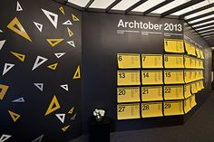 Installation of triangle rulers and the Archtober calendar in the visitors lounge. The isosceles rulers are the only ones to be found in the exhibition graphics.
