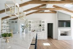 California Ranch Home for Sale Pale Blue Walls, White Walls, Ranch Homes For Sale, Accent Wall Colors, California Ranch, Wicker Dining Chairs, White Paint Colors, Colored Ceiling, Wall Molding