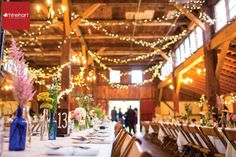 Country wedding barn decor: hand-painted wooden table numbers, antique bottles with unique blooms and lots of lights, Yellow Barn Lancaster Wedding Photographer-127