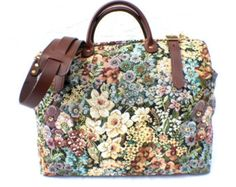 This Carpet Style Travel Bag is Ideal for Business or Pleasure use, whether Catching a Flight to New York or a Train to Paris for the Weekend, this Classically Designed Bag will get everything you need there in style!  Measuring 18 L x 8 W x 14H, this Timeless British Classic Bag is Constructed using the Finest Leather and Tapestry Fabric and with Quality Brass Hardware, Steel Frame, Heavy Duty Sewing Thread, Copper Saddlers Rivets, and Five Brass Feet. It really will last you a lifetime…
