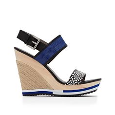 Sport-inspired wedges? Yes please! Run around the city in these trendy wedges with loose pants and a simple cotton tee.Material: Leather