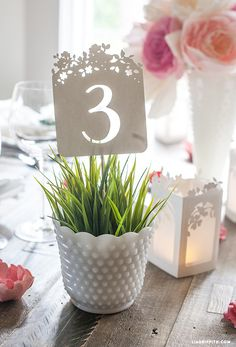 Found it at Blitsy - 14 Gorgeous DIY Wedding Table Numbers