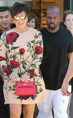 Kris Jenner paired a fabulous floral print frock with hippy-inspired round sunnies with gold flash lenses for shady flair!