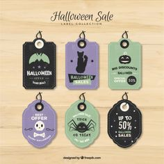 Halloween discounts label collection Free Vector