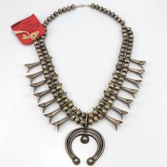 Vintage (1940s) Sterling Silver Squash Blossom Necklace withLong Squash Blossom Beads and aClassic Naja. This Squash Blossom Necklace comes with the old pawn