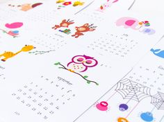 Printable 2017 calendar featuring cute animal illustrations for each month of the year! Print out the templates, cut, fold and paste to make your own little table-top calendar with a pretty stand.  Say hello to a vibrant 2017 with an adorable calendar for your studio table or kid's room! It includes a pink polka dots bow tie stand template as well.