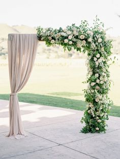 Romantic half fabric and half floral decorated wedding arch ideas