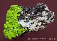 Autunite - a uranium bearing (radioactive) phosphate, a tetragonal mineral with chemical formula Ca(UO2)2(PO4)2.12(H20).  Beautiful, but dangerous!