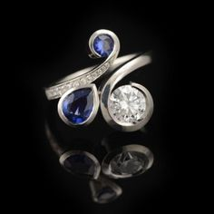 This beautiful, one-of-a-kind engagement ring is a very recently finished commission. Made in platinum with blue sapphires and white diamonds by McCaul Goldsmiths. #bespoke #colouredgemstone #commission