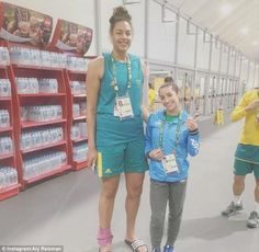 Little and large! Meanwhile Aly posted a comical image of herself posing with a basketball player, while joking about their difference in height