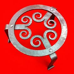 Hand forged trivets. http://www.facebook.com/CJForgeBlacksmith #blacksmith #forged #trivet
